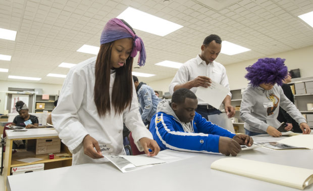 Westinghouse High School students visit and receive hands-on experience at the University Archive Center on Thomas Blvd, Thursday, January 25, 2018