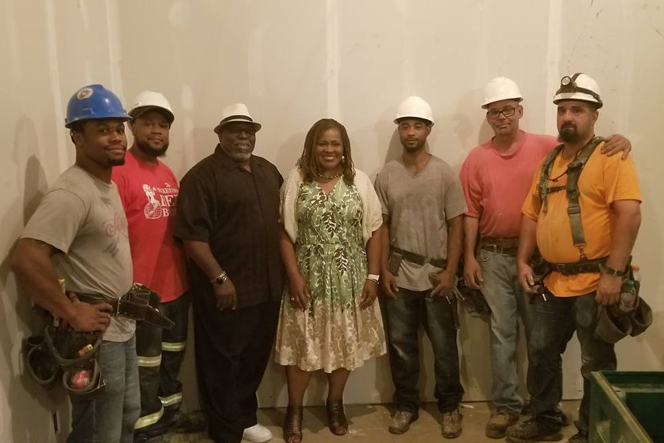 A photo of Dr. Kathy Humphrey with construction workers building the CEC in Homewood